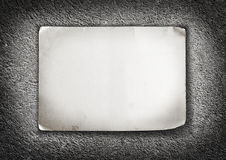 Paper sheet with shabby corners on concrete background Stock Photo