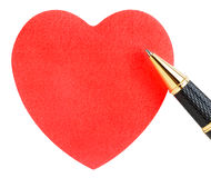 Paper sheet in the shape of a heart with pen Stock Photos