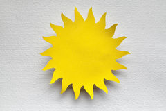 Paper sheet in the shape of sun. Paper sheet in the shape of the sun Royalty Free Stock Photo