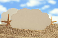 Paper sheet and shells on beach Royalty Free Stock Images