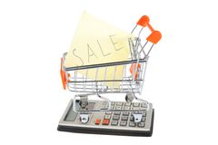 Paper sheet in shopping cart, calculator isolated Royalty Free Stock Photo