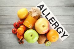 Paper sheet with text ALLERGY and food stock image