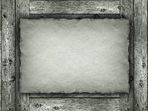 Paper sheet on wood background Royalty Free Stock Photo