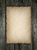 Paper sheet on wood background Royalty Free Stock Photos