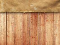 Paper sheet on wooden wall background Stock Photos