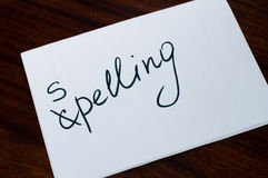 Paper sheet with word spelling Stock Images