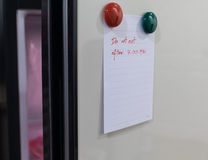 Paper sheet write Do not eat after 7.00 pm on refrigerator door Royalty Free Stock Photography