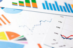 Paper sheets with business graphs and charts. Paper sheets with colorful business graphs and charts royalty free stock images