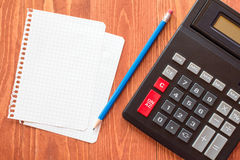 Paper sheets and calculator Royalty Free Stock Photos