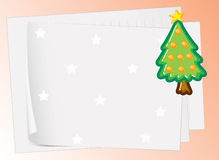 Paper sheets and christmas tree Stock Image