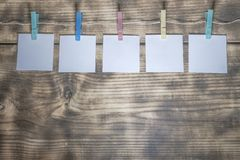 Paper sheets hung on a stitch royalty free stock image