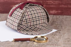 Paper sheets and magnifying glass Royalty Free Stock Image