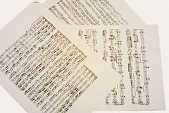 Paper sheets with old musical notes Stock Photos