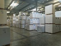 Paper sheets palletized at the warehouse Stock Photos