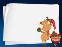 Paper sheets and reindeer Royalty Free Stock Photo