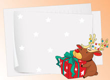 Paper sheets and a reindeer Stock Photos