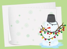 Paper sheets and a snowman Royalty Free Stock Photos