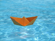Paper ship blue water Royalty Free Stock Images