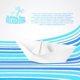 Paper ship on blue waves. Stock Photo