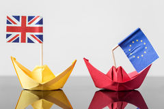 Paper ship with british and european flag. Concept shipment or free trade agreement and membership of eu, brexit Royalty Free Stock Photo
