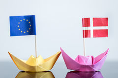 Paper ship with danish and european flag. Concept shipment or free trade agreement and membership of eu Stock Photos