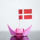 Paper ship with danish flag. Concept shipment or free trade agreement Stock Images
