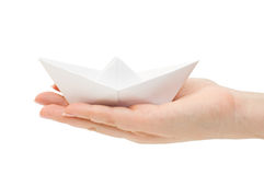 Paper ship in a female hand Stock Photography
