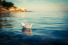 Paper Ship Floating in the Sea. Toned Photo. Royalty Free Stock Image