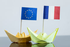 Paper ship with french and european flag. Concept shipment or free trade agreement and membership of eu or nato Royalty Free Stock Photography
