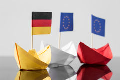 Paper ship with german and european flag. Concept shipment or free trade agreement and membership of eu Stock Images