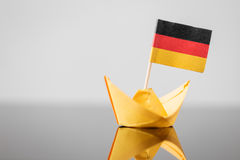 Paper ship with german flag. Concept shipment or free trade agreement Stock Image