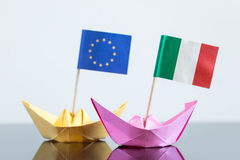 Paper ship with italian and european flag. Concept shipment or free trade agreement and membership of eu Stock Photo