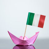 Paper ship with italian flag. Paper ship with italian and european flag, concept shipment or free trade agreement and membership of eu Stock Photo