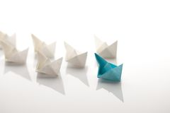 Paper ship. Leadership concept using blue paper ship among white Royalty Free Stock Images