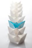 Paper ship. Leadership concept using blue paper ship among white Stock Image