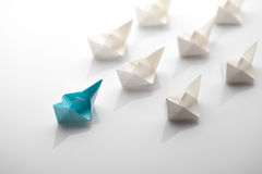Paper ship. Leadership concept using blue paper ship among white Stock Photos