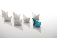 Paper ship. Leadership concept using paper ship among white Royalty Free Stock Photos