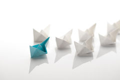 Paper ship. Leadership concept using paper ship among white Royalty Free Stock Images
