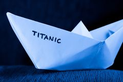 Paper ship model - titanic. Origami paper ship model in blue - titanic concept Stock Photos
