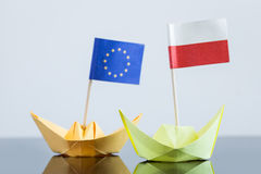 Paper ship with polish and european flag. Concept shipment or free trade agreement and membership of eu Stock Photography