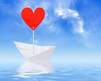 Paper ship with red heart sail Stock Photography