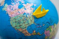 Paper ship on sea. Go to america Stock Photos