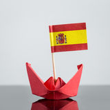 Paper ship with spanish flag. Concept shipment or free trade agreement Royalty Free Stock Image
