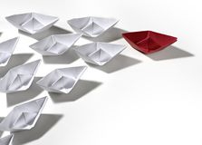 Paper ship team. Red paper ship leading race Royalty Free Stock Photography