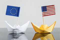 Paper ship with usa and european flag. Concept shipment or free trade agreement and membership of eu, nato Royalty Free Stock Image