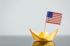 Paper ship with usa flag. Concept shipment or free trade agreement, travel Royalty Free Stock Images