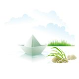 The paper ship on water about a grass Royalty Free Stock Images