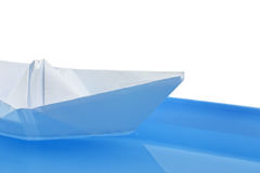 Paper ship in water on white Stock Image