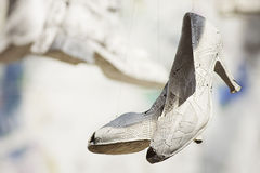 Paper shoes. A pair of shoes covered in maps Royalty Free Stock Images
