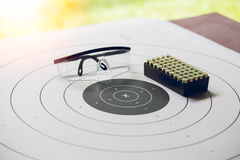 Paper shooting target with bullet and protection glassess Royalty Free Stock Photography